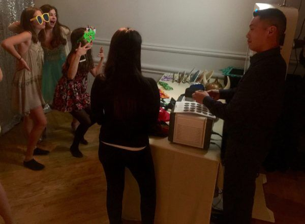 Bat Mitzvah guests having fun with Expressway Music Photo Booth