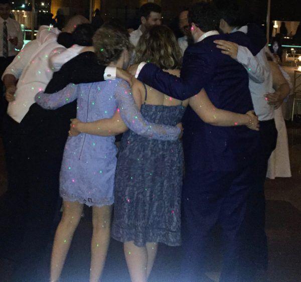 Friends bonding moment at wedding