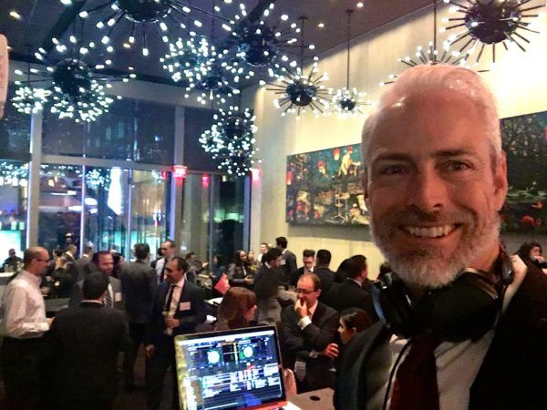 close up of dj greg at holiday event for ernst & young