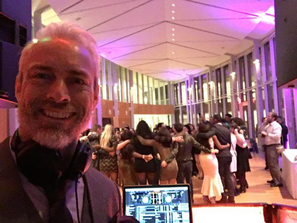 full dance floor behind DJ Greg