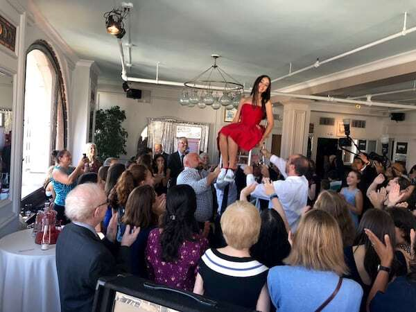 bat mitzvah girl lifted during Hora