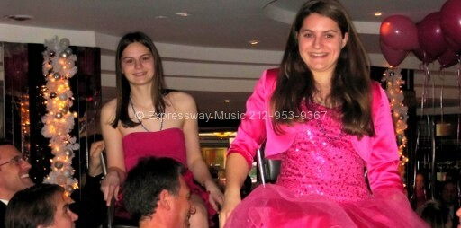B'nai Mitzvah Twins on Chair during Horah