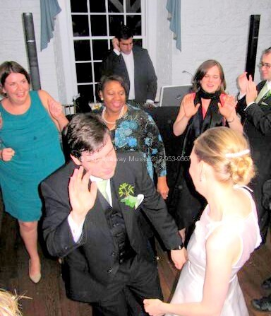 Bride and Groom first dance with DJ Dave Swirsky in Backround