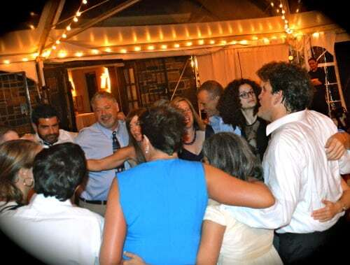 friends and family dance shot at wedding