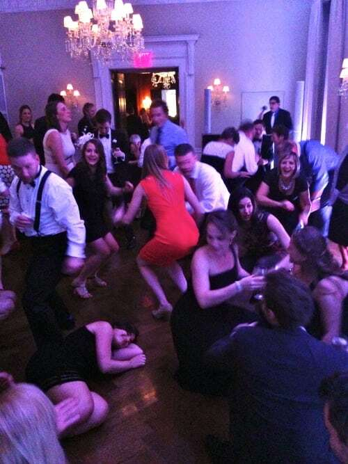 Wedding guests getting down on the dance floor at the Harold Pratt House