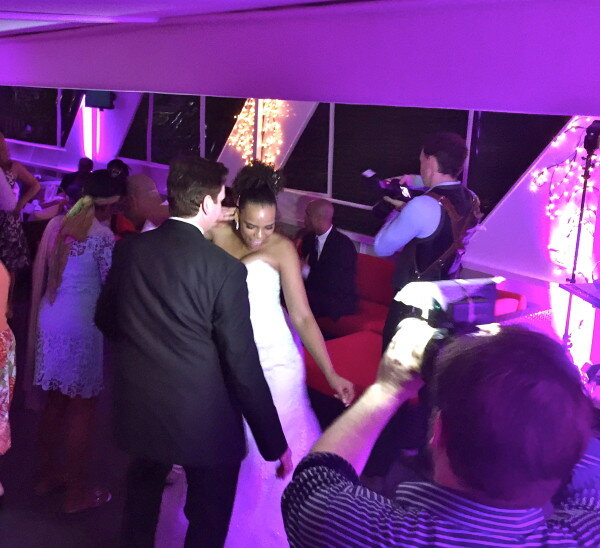 Groom and Bride dancing on yacht