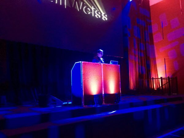 DJ Owner of Expressway Music on stage at eh Ziegfeld Ballroom