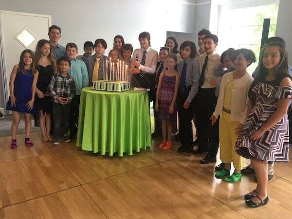 Bar Mitzvah Boy's Friends lighting candle