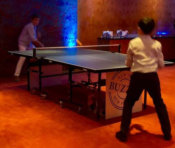 ping pong players at Ben's Bar Mitzvah