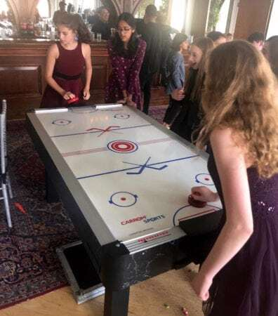 Bat Mitzvah guests playing Air Hockey