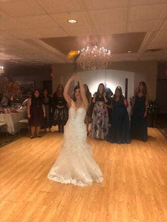 bride about to throw bouquet