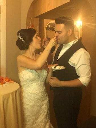 bride feeds cake to groom