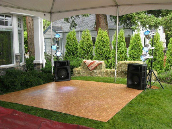 Portable dance floor under small tent