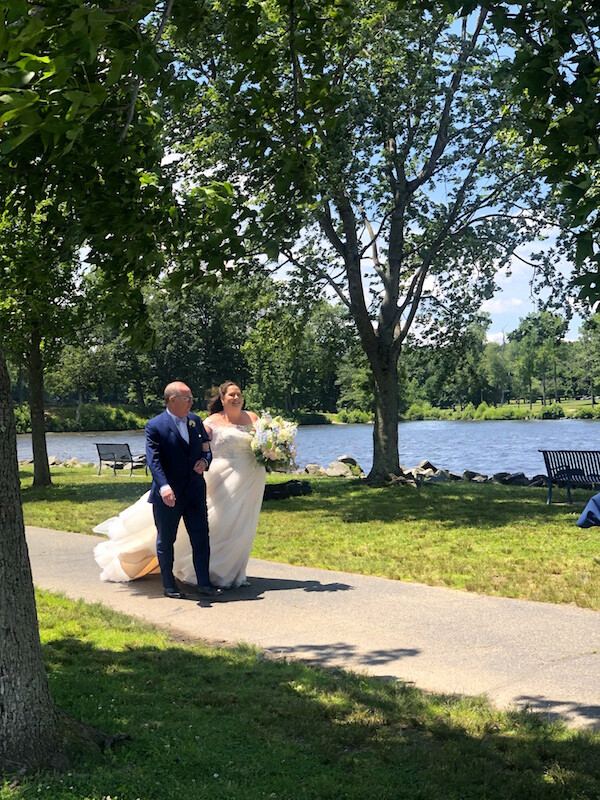Father walk Bride down aisle by Lake to be married