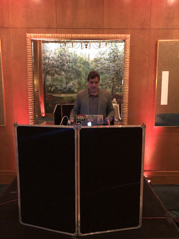 DJ on stage for wedding reception