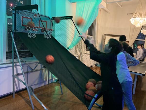 Kids playing pop a shot basketball