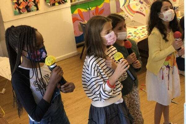 Kids practicing safe karaoke singing with masks due to COVID-19